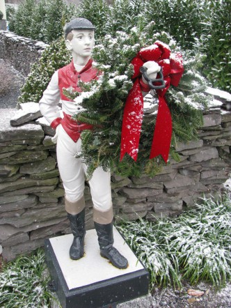 Jockey with wreath.